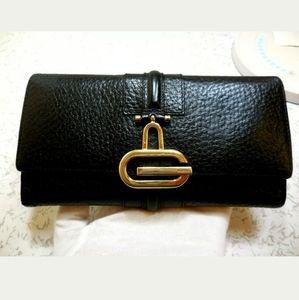 Auth Gucci black grained leathet long logo wallet